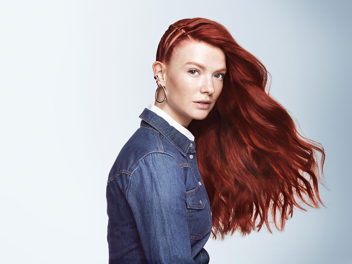 Woman with long red wav hair