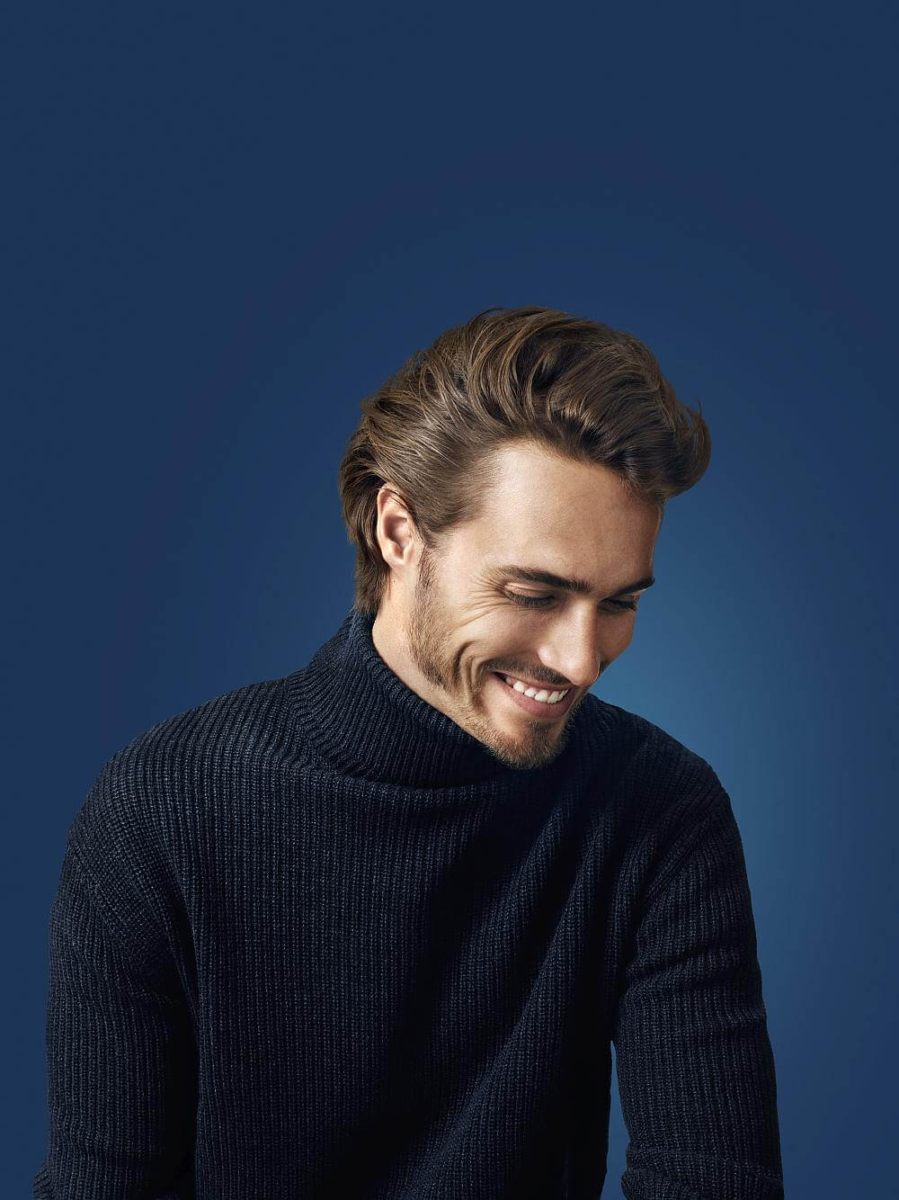 Man smiling with long quiff